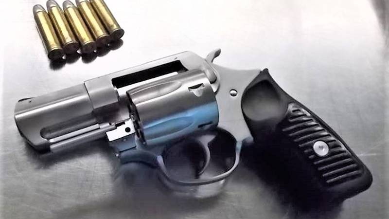 Officials say a TSA officer spotted a .357 caliber revolver loaded with five bullets in the...