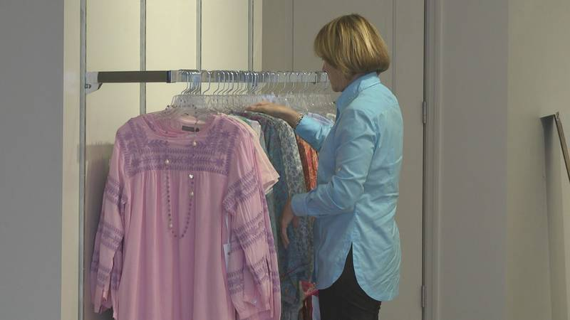 Susan Trachik looks over inventory she purchased for her new store she cannot open because of...