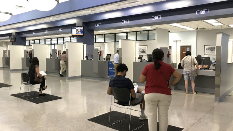 Virginia DMV customers are socially distanced when awaiting their scheduled appointments.