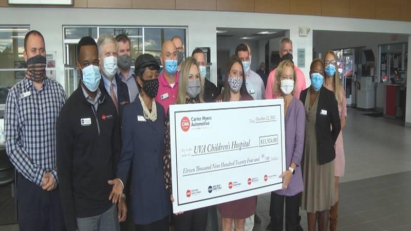 Carter Meyers Automotive representatives presenting a check to UVA Children's Hospital.
