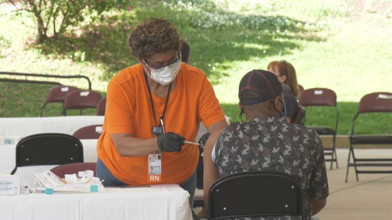 A UVA Health vaccine administrator gives a COVID-19 vaccine at a pop-up clinic on May 21, 2021.