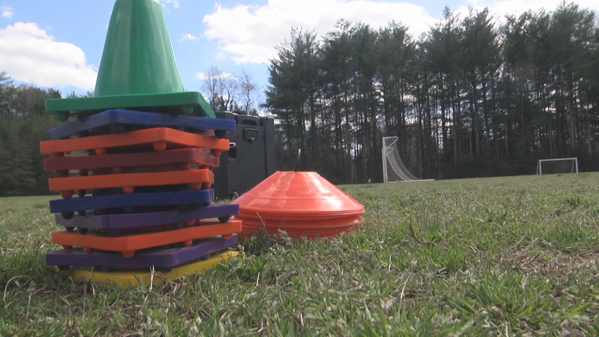 Cones on a field where Pop-Up P.E. holds a class for virtual learning students.