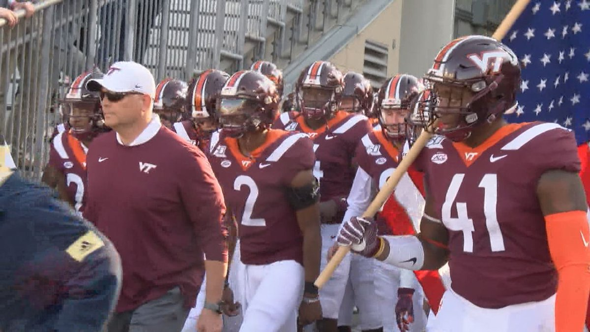 Hokies enter field at Georgia Tech before a 45-0 win over the Yellow Jackets.